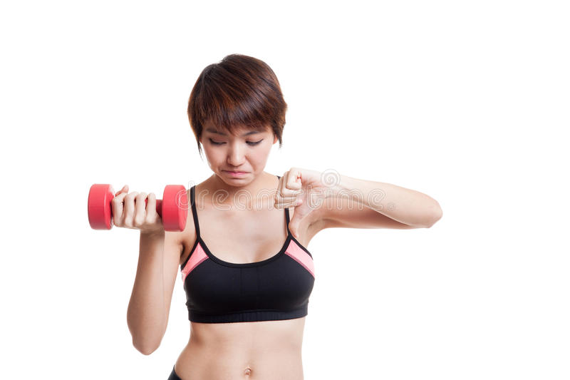 Beautiful Asian healthy girl thumbs down with dumbbell. Beautiful Asian healthy girl thumbs down with dumbbell isolated on white background royalty free stock photos