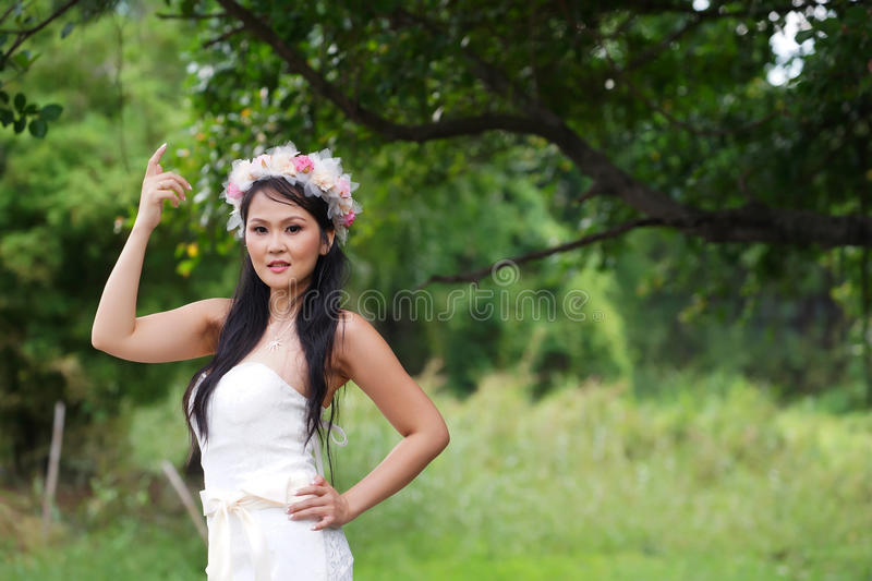 Download Beautiful Asian Lady White Bride Dress, Posing In The Forest Stock Image - Image: 32174919