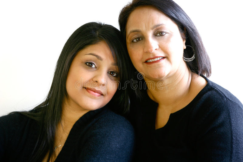Beautiful Asian mom and daughter. royalty free stock image