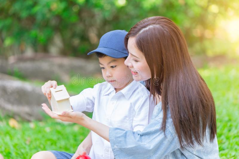 Beautiful asian mother playing with her lovely son royalty free stock photography