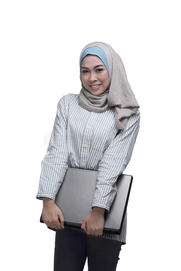 Beautiful asian muslim woman holding laptop. Isolated over white background stock image