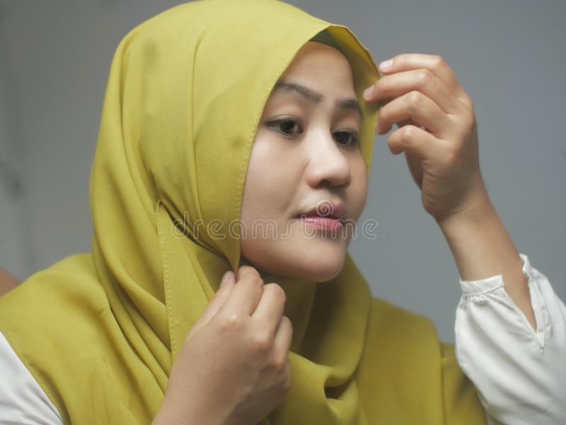 Beautiful Asian muslim woman wearing hijab on, head scarf for muslim woman, islamic religion concept. Beautiful Asian muslim woman wearing hijab on in front of stock photography