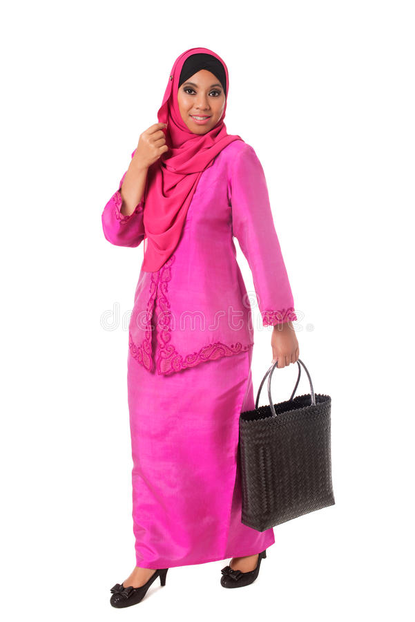Beautiful asian muslimah woman with black wicker tote bags.Isolated stock photography