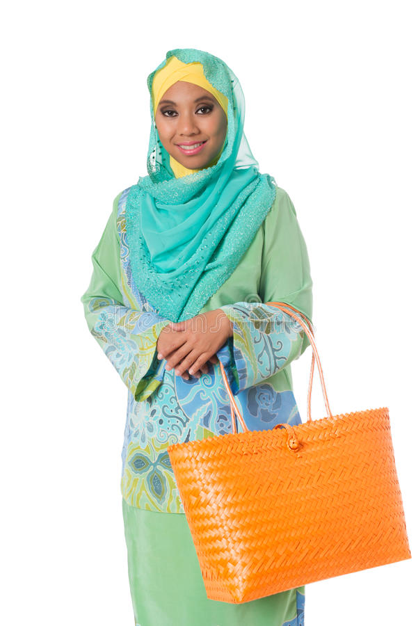 Beautiful asian muslimah woman with bright orange wicker tote ba stock image