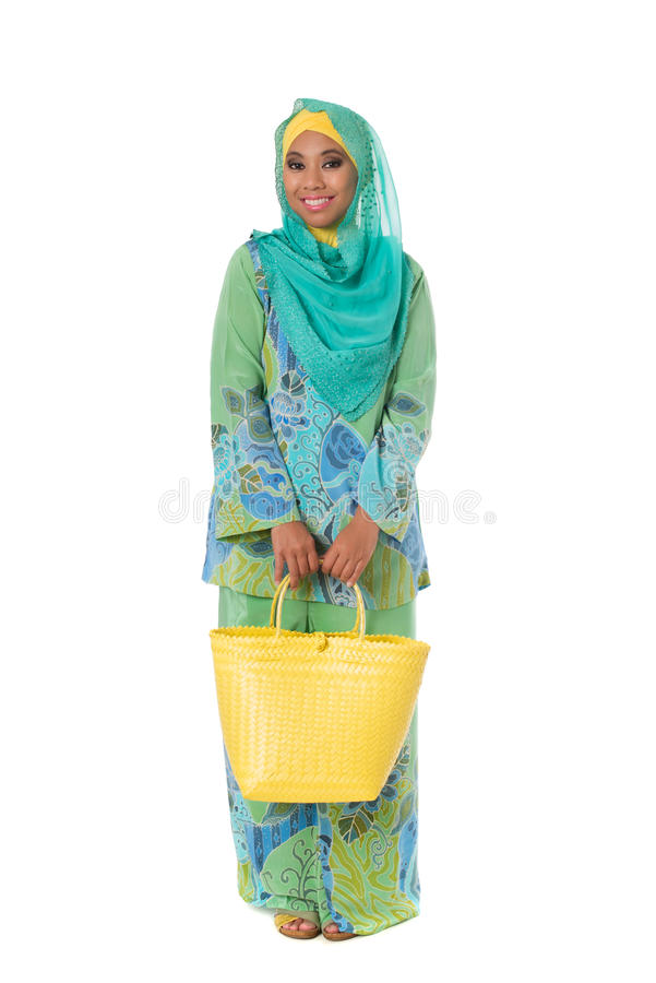 Beautiful asian muslimah woman with bright wicker tote bags.Isolated royalty free stock images