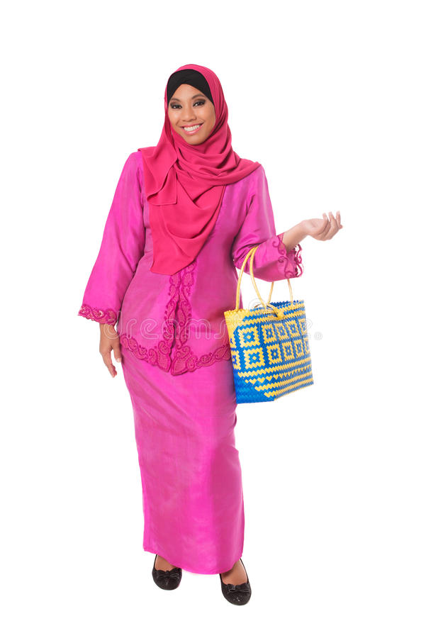 Beautiful asian muslimah woman with bright wicker tote bags.Isolated stock photography