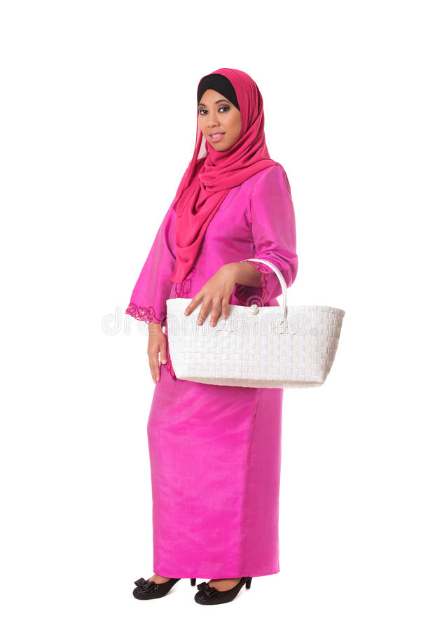 Beautiful asian muslimah woman with white wicker tote bag.Isolated stock photography