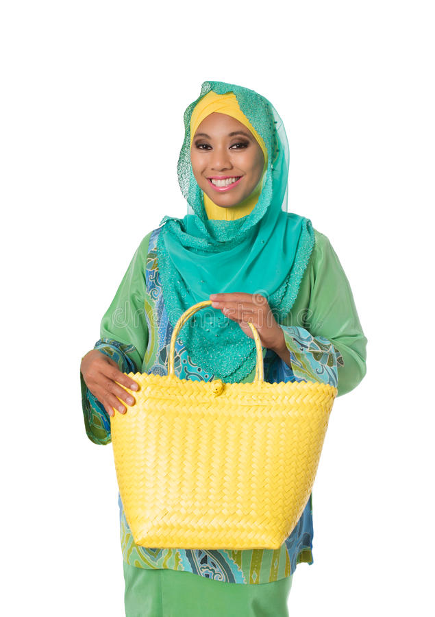 Beautiful asian muslimah woman with yellow wicker tote bag.Isolated royalty free stock photo