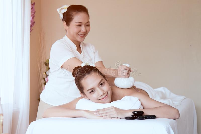 Beautiful Asian teenager getting Spa Treatment stock photos