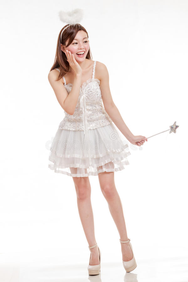 Beautiful Asian Woman in Angel Costume laughing, i stock photo