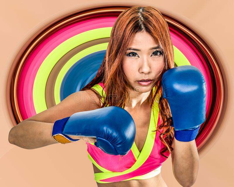 Beautiful Asian woman boxer with circular color stretch in background royalty free stock image