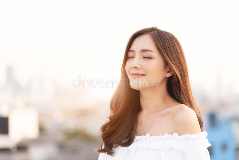 Beautiful Asian Woman is breathing fresh air royalty free stock photo