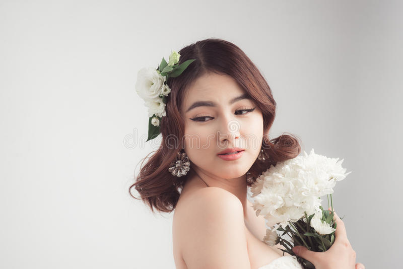 Beautiful asian woman bride on grey background. Closeup portrait royalty free stock image