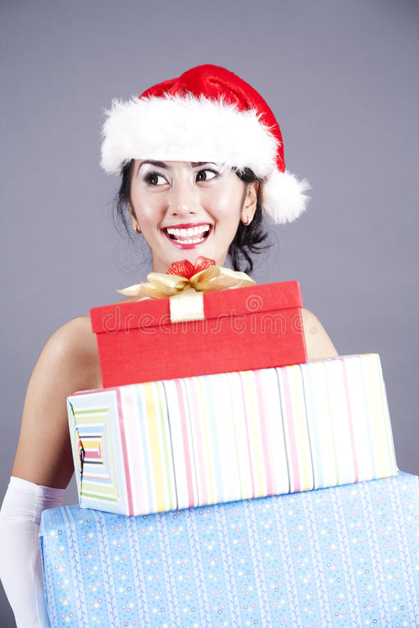 Download Beautiful Asian Woman Carrying Christmas Gifts Stock Photo - Image of gift, friendly: 22416472