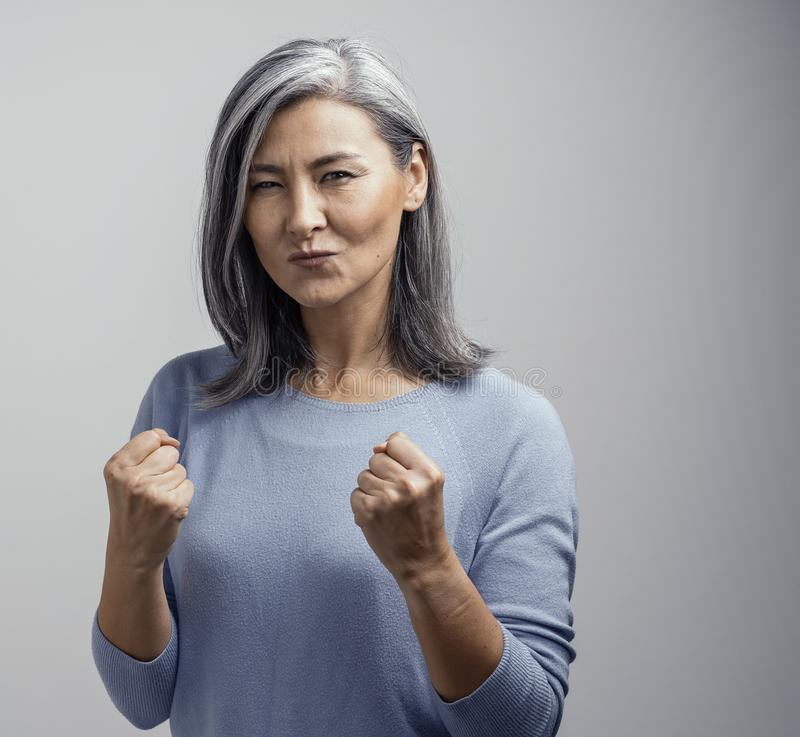 Beautiful Asian woman celebrates her victory. Portrait stock photography
