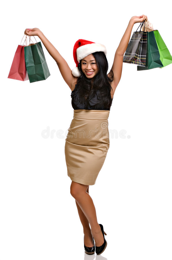 Beautiful Asian woman Christmas shopping royalty free stock images