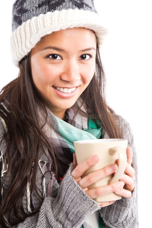 Beautiful asian woman drinking coffee royalty free stock image