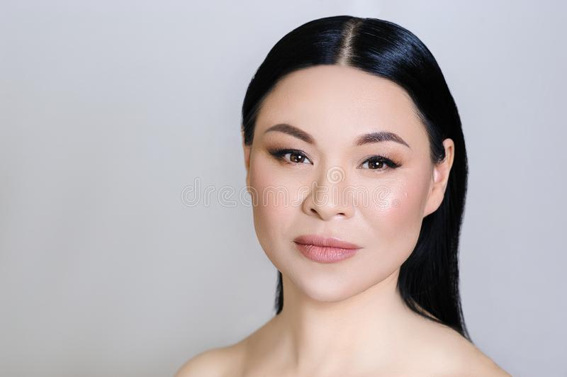 Beautiful asian woman face with clean fresh skin, nude makeup, cosmetology, healthcare, beauty and spa stock image