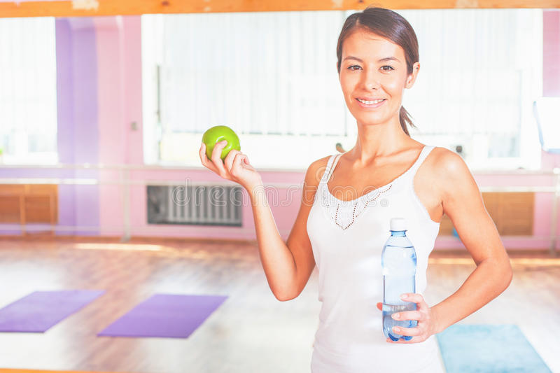 Beautiful asian woman fitness exercise, holding bottle with water royalty free stock images