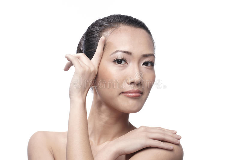 Download Beautiful Asian Woman Gently Touching Her Face. Stock Photography - Image: 20575602