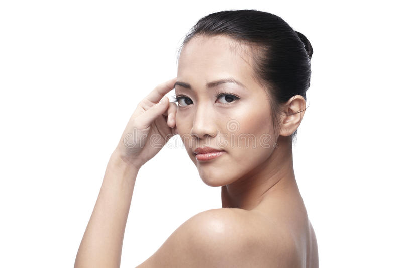 Download Beautiful Asian Woman Gently Touching Her Face. Royalty Free Stock Image - Image: 20575616