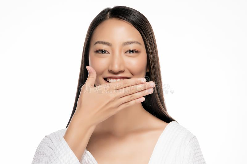 Beautiful Asian woman hands gag on White Blackground.  stock photography