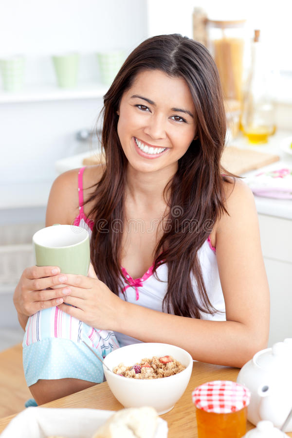 Beautiful asian woman having breakfast and smiling