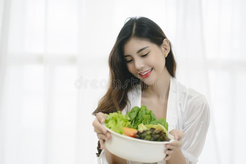 Beautiful Asian woman with healthy food. Heathy life style and Beautiful skin care food concept stock photos