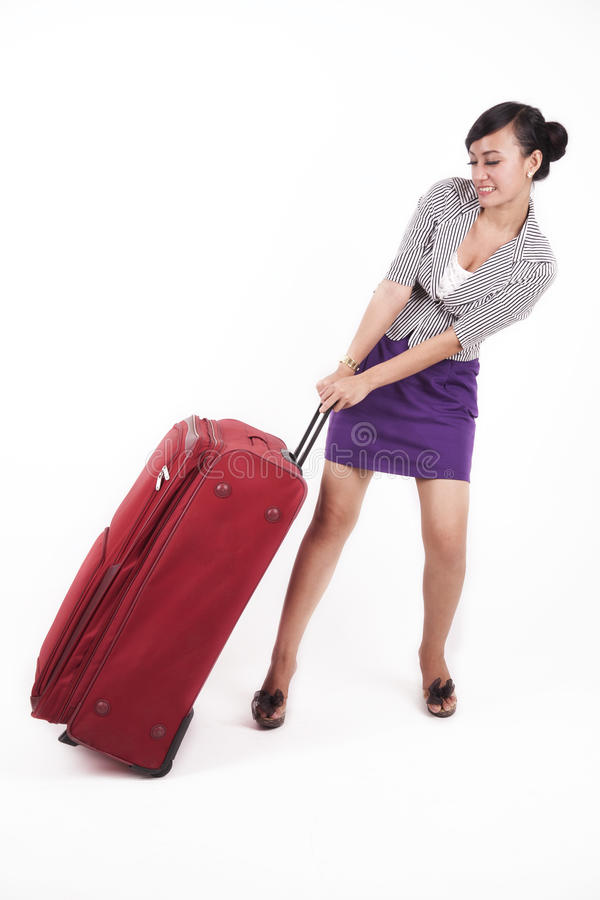 Download Beautiful Asian Woman With Heavy Suitcase Stock Photo - Image: 21987400