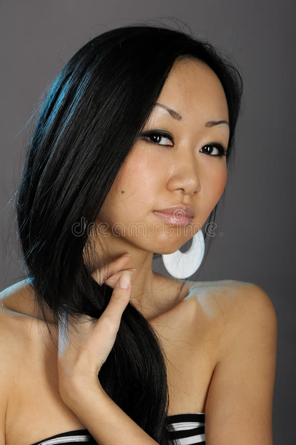 Beautiful asian woman hold her hair royalty free stock photography