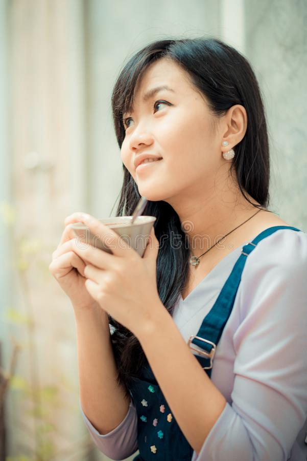 Beautiful asian women hold hot latte coffee royalty free stock image