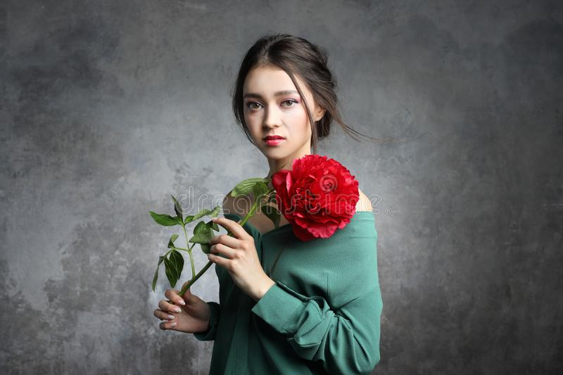 Beautiful asian woman hold  peony flower. Cosmetics, make-up. Perfumery concept stock image