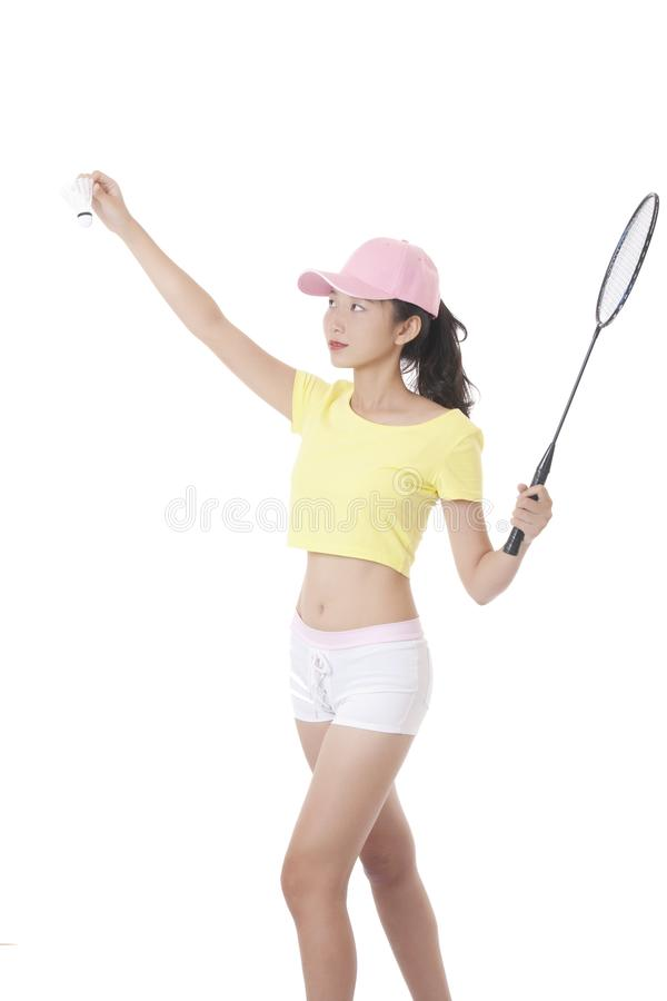 Beautiful Asian woman holding a badminton racket isolated on white background. Portrait of a beautiful Asian woman holding a badminton racket isolated on white stock photography