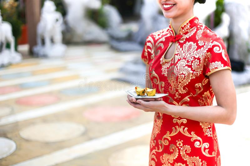 Beautiful asian woman holding dollars or money with lucky pocket money,in the Chinese New Year. Festivities, New Year Celebration stock photo