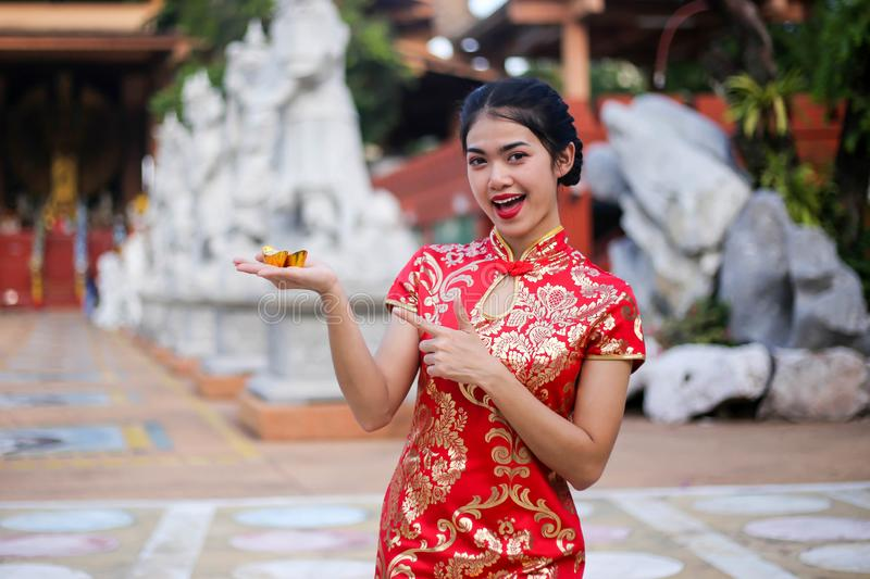 Beautiful asian woman holding dollars or money with lucky pocket money,in the Chinese New Year. Festivities, New Year Celebration royalty free stock photography