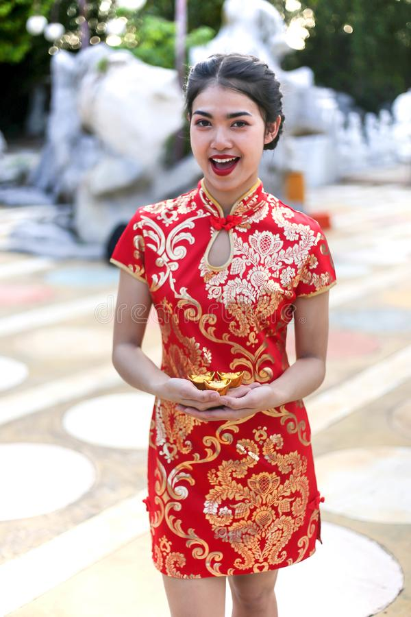 Beautiful asian woman holding dollars or money with lucky pocket money,in the Chinese New Year. Festivities, New Year Celebration stock photography