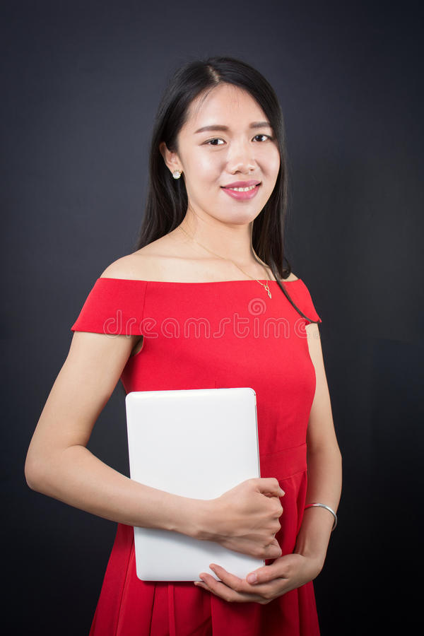 Beautiful Asian woman holding a laptop. Computer stock photos