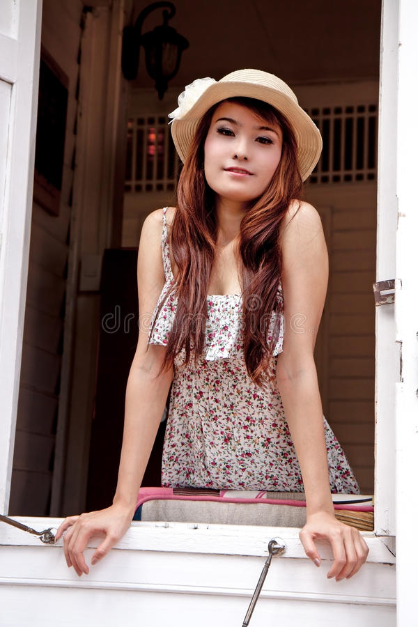 Download Beautiful Asian Woman Looking Out Of The Window Stock Photo - Image: 24371190