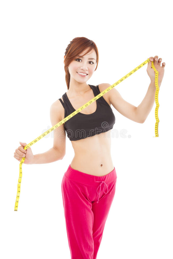 beautiful asian woman with measure tape royalty free stock photography