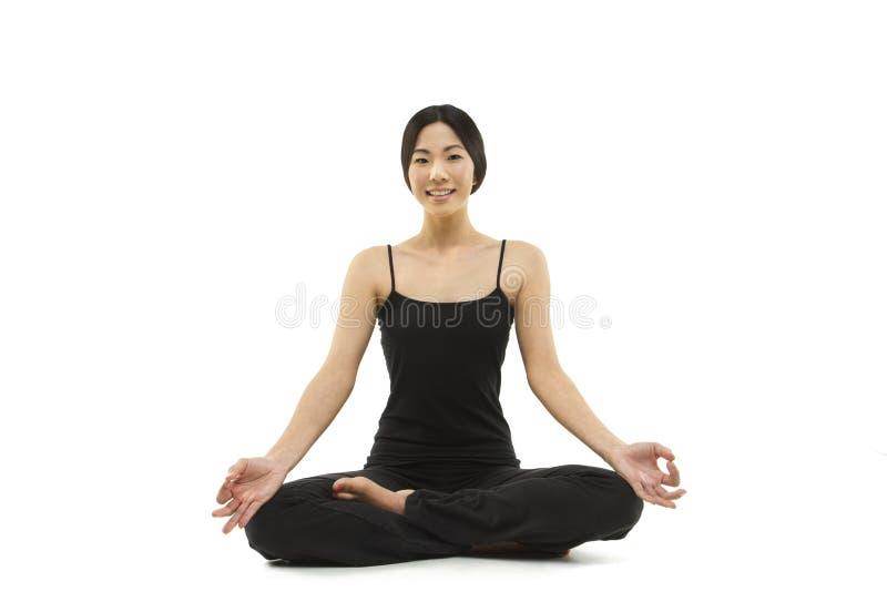 A beautiful Asian woman meditating stock photos
