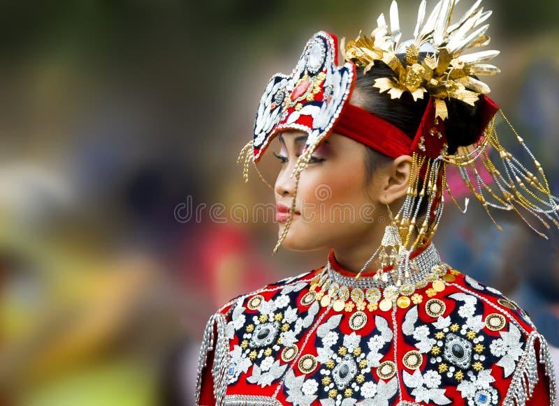 Beautiful asian woman, national dress. Blured background. The beautiful asian Koreanyoung woman in the national dress is on the blurred background. Seychelles royalty free stock photos