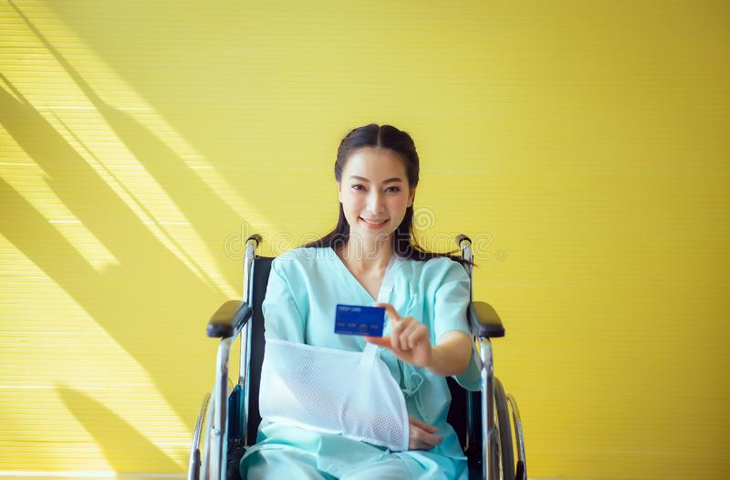 Beautiful asian women patients showing up health card,Positive thinking,Insurance policy concept,Copy space for text. Beautiful asian woman patients showing up royalty free stock image