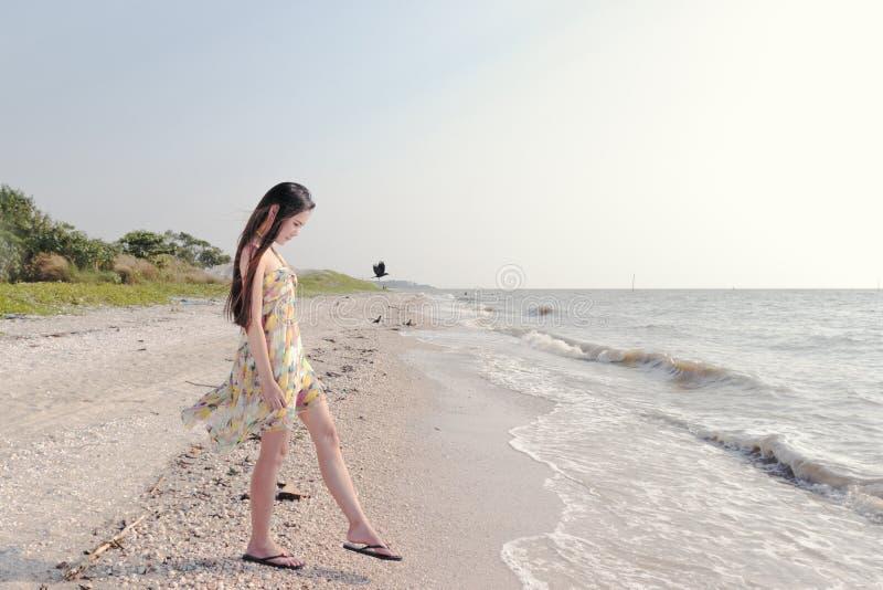 Beautiful asian woman at the beach royalty free stock photo