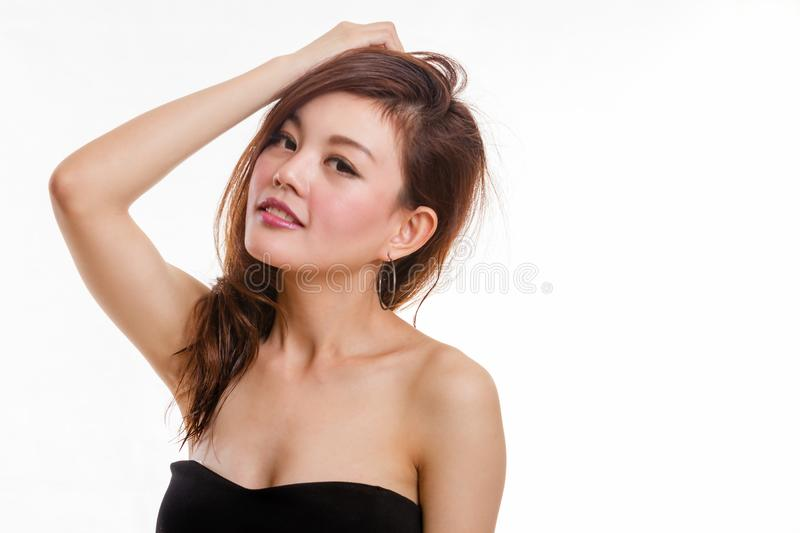 Beautiful Asian woman plays with hair royalty free stock photography