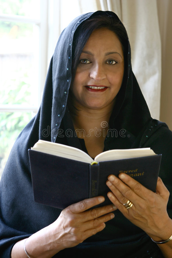 Download Beautiful Asian Woman Reading Her Religious Book Stock Image - Image: 1978727