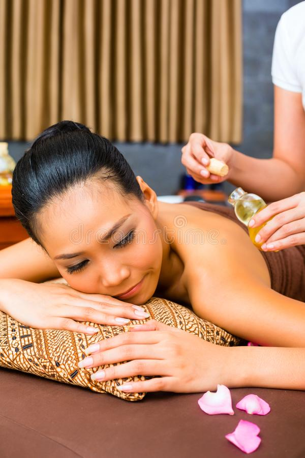 Beautiful Asian woman receiving massage royalty free stock photography