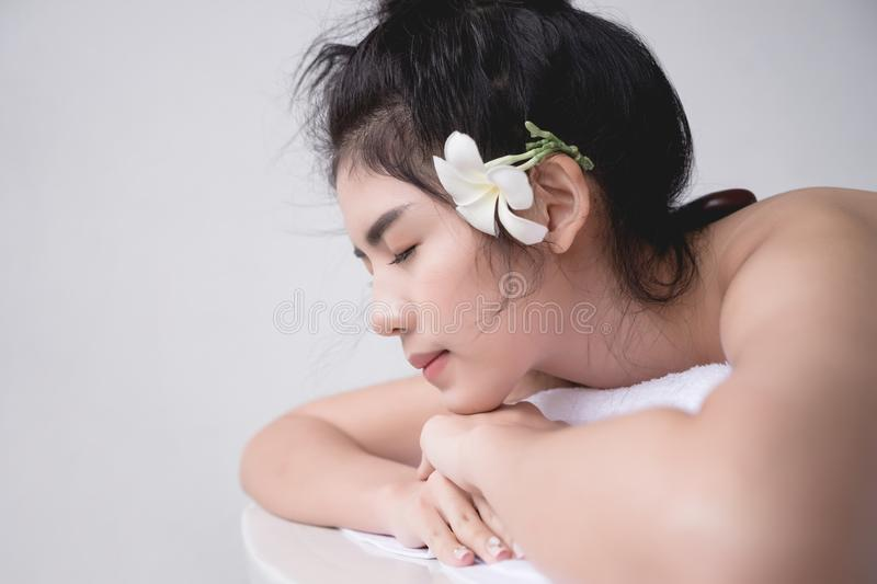 Beautiful Asian woman relaxing with hand massage treatment at be stock photos