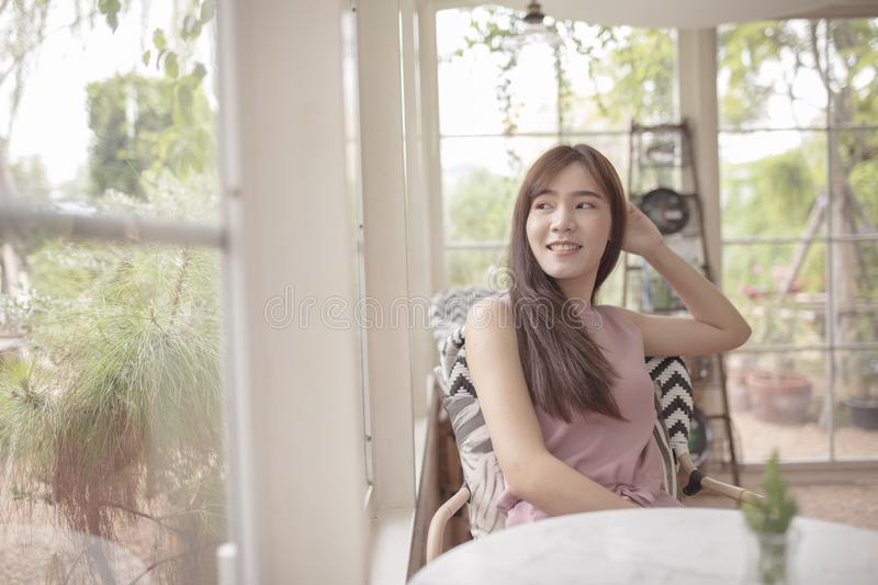 Beautiful asian woman relaxing in home living room royalty free stock images