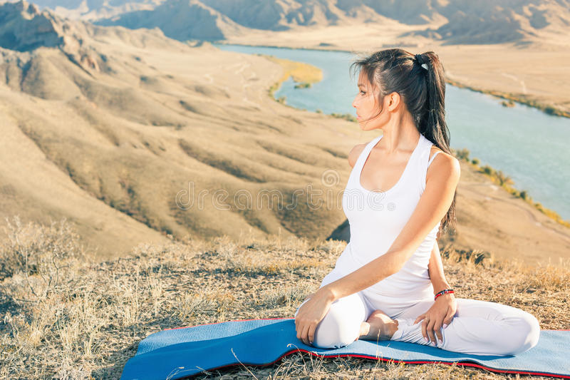 Beautiful asian woman relaxing and meditating outdoor at mountai royalty free stock photo