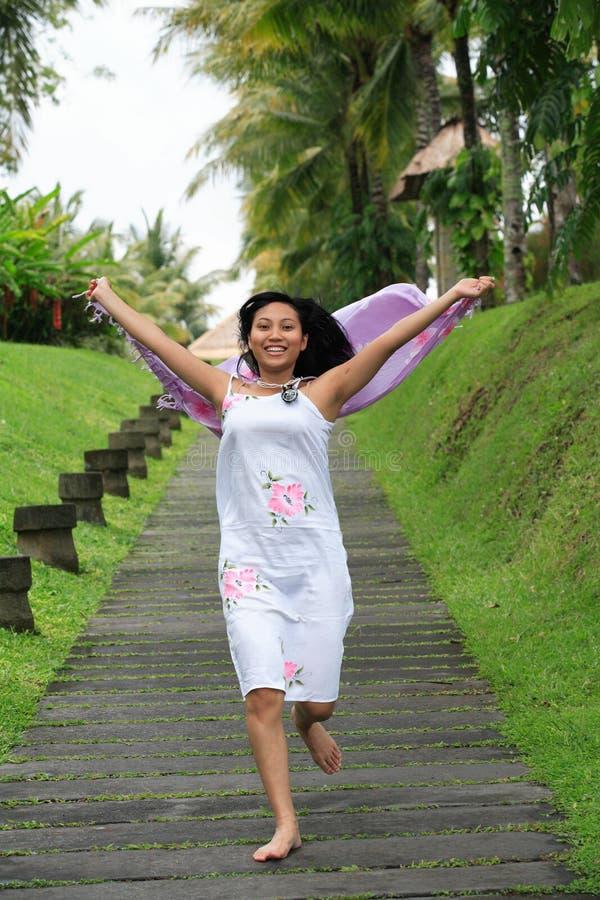 Beautiful Asian Woman Running Stock Photo